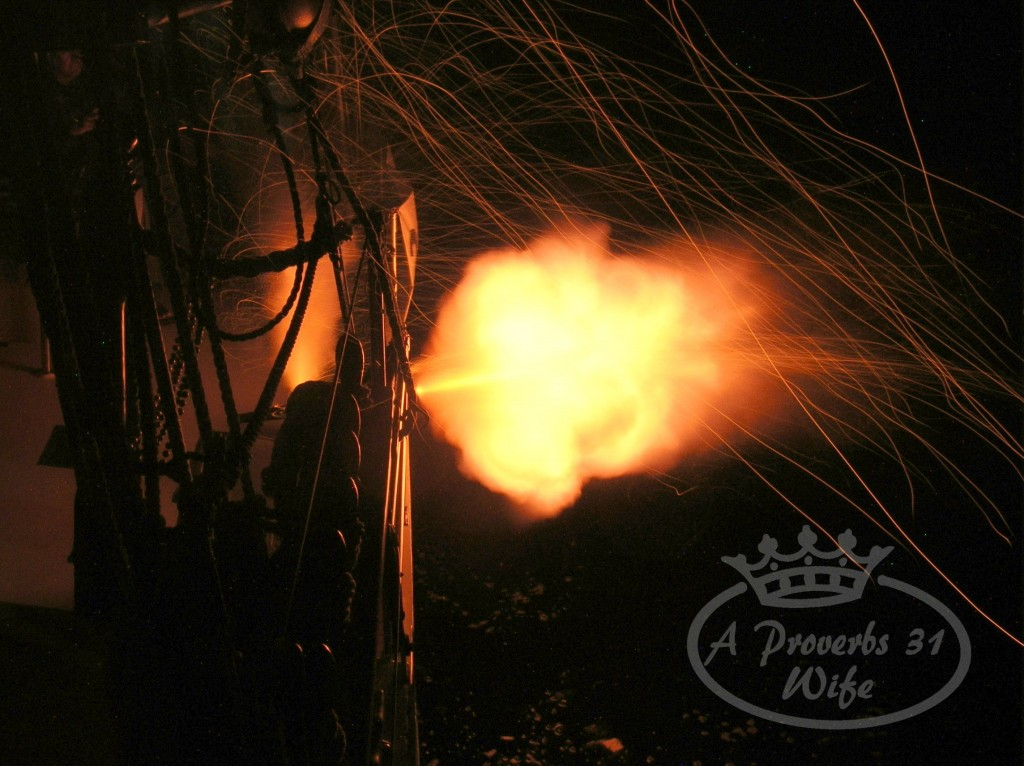 black powder cannon firing at night