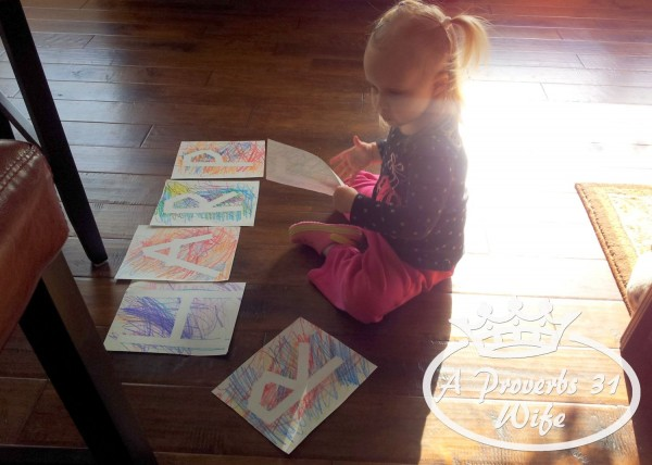 Puting the letters in order to make her name. Such a fun craft!  #preschoolcraft #letters craft
