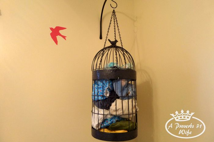 Bird cage diaper holder