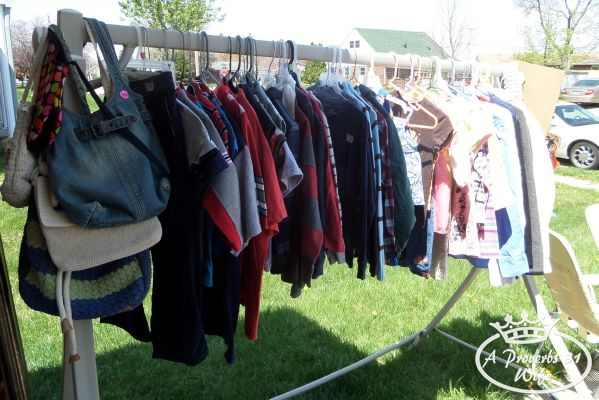 Garage sale ideas. Hang all clothes if possible