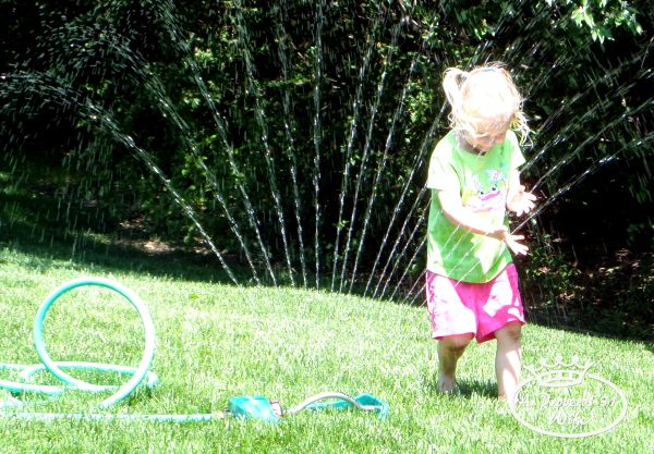 running through a sprinkler