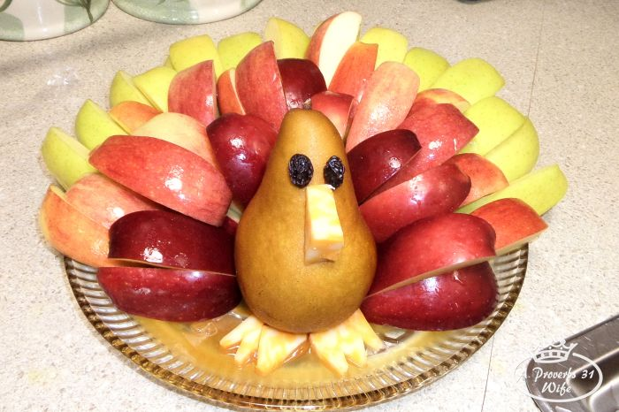 how to make a caramel apple fruit turkey centerpiece for your Thanksgiving table