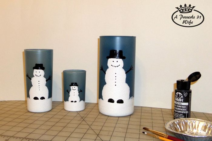 Painted snowmen with eyes, arms, hat, and buttons