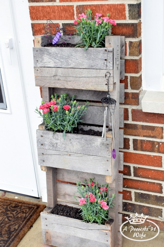 Pallet planter for butterflies with plants that attract pollinators