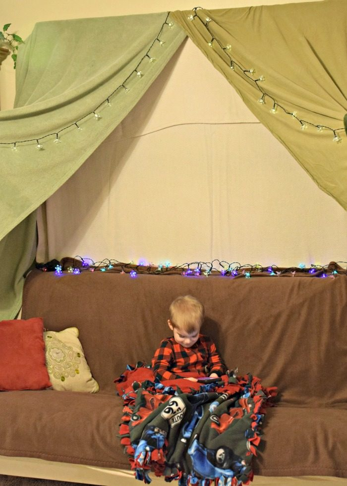 Create a cuddle up movie night with your toddler! Make a blanket fort, no sew sleep sack, fruits, and a free movie credit from VUDU. #YourTaxCash #ad