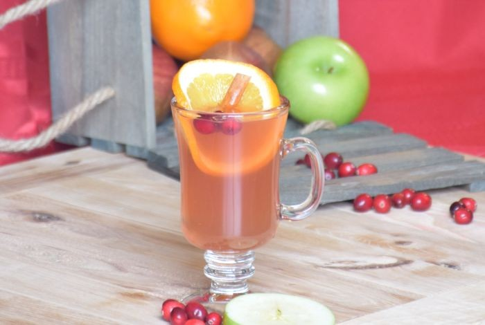Get a taste of the Christmas with this sweet and tangy cranberry orange spiced cider recipe. Easily made in your crockpot and truly a healthy treat since the only sugar comes from your fruit!